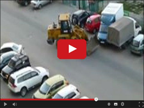 Koparko-spycharka i problemy z parkowaniem
